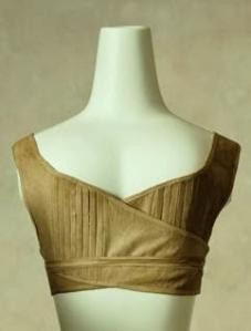 A partir de 1804, les femmes portent des brassières. Ici elle est faite de toile brune.